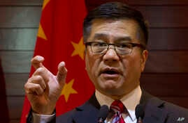 Outgoing U.S. ambassador to China, Gary Locke gestures as he speaks during a farewell press conference held at the U.S. Embassy in Beijing, China, Feb. 27, 2014.