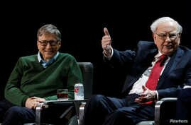 Warren Buffett, chairman and CEO of Berkshire Hathaway, speaks while Bill Gates looks on at Columbia University in New York, Jan. 27, 2017.