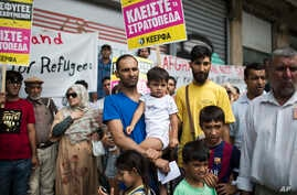 FILE - Afghan refugees in Greece protest, demanding more rights for themselves, in central Athens, Aug. 22, 2017.