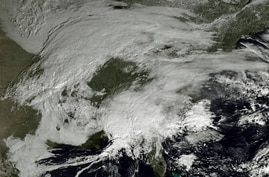 This image made available by NOAA shows storm systems over the eastern half of the United States on, Feb. 7, 2013.