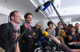 (From L) Romain Striffing, brother of Albane Moulin-Fournier, and Nicolas Moulin-Fournier, brother of Tanguy and Cyril Moulin-Fournier, speak to journalists in Paris, on April 19, 2013 after relase.