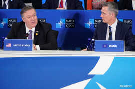 U.S. Secretary of State Mike Pompeo speaks as NATO Secretary General Jens Stoltenberg (R) listens during a meeting of the North Atlantic Treaty Organization (NATO) Foreign Ministers at the State Department in Washington, U.S., April 4, 2019.
