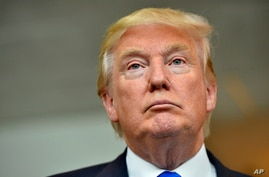 Republican presidential candidate Donald Trump listens during a news conference after speaking at the TD Convention Center, in Greenville, South Carolina, Aug.  27, 2015.