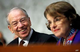 Senate Judiciary Committee Chairman Chuck Grassley, R-Iowa, left, looks to ranking member Sen. Dianne Feinstein, D-California, as Attorney General Jeff Sessions testifies before the Senate Judiciary Committee on Capitol Hill in Washington, Oct. 18, 2