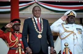 "Kenya's president Uhuru Kenyatta (C) attends the Independence Day ceremony, called Jamhuri Day (""Republic"" in Swahili) at Kasarani stadium in Nairobi, Kenya, on December 12, 2017.  / AFP PHOTO / YASUYOSHI CHIBA"