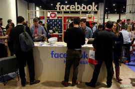vFILE - People stop at the Facebook booth at the Conservative Political Action Conference (CPAC) at National Harbor, Maryland, U.S., Feb. 23, 2018.
