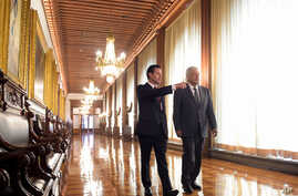 In this photo released by Mexico's presidential press office, Mexico's President-elect Andres Manuel Lopez Obrador, right, is escorted by Mexico's current President Enrique Pena Nieto through the National Palace in Mexico City, July 3, 2018.
