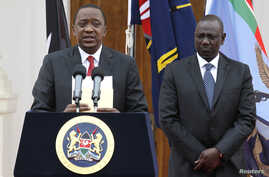 Kenyan President Uhuru Kenyatta, left, with Deputy President William Ruto, addresses a news conference at the State House in Nairobi, Dec. 2, 2014.