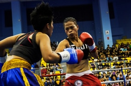 Huang Wensi fights against Thailand's Jarusiri Rongmuang for the Asia Female Continental Super Flyweight Championship gold belt in Taipei, Taiwan, Sept. 26, 2018.