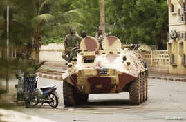 Malian military junta troops who carried out a coup in March guard a street after renewed fighting in the capital Bamako May 1, 2012