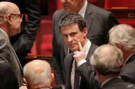 French prime minister Manuel Valls, center, leaves the France's National Assembly, in Paris, Wednesday, Feb. 10, 2016.