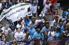 Demonstrators walk through the streets of Nairobi, Oct. 3, 2015, participating in a Global March to support wildlife Elephants and Rhinos.