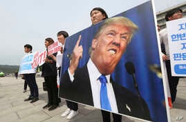 Protesters with a portrait of U.S. President Donald Trump stage a rally against the United States' policies near the U.S. embassy in Seoul, South Korea, May 25, 2018.