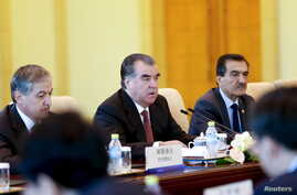 FILE - Tajikistan President Imomali Rahmon attends a meeting with Chinese President Xi Jinping (unseen) at the Diaoyutai State Guesthouse in Beijing, China, Sept. 2, 2015.