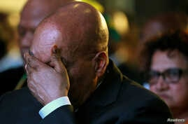 FILE - South Africa's President Jacob Zuma reacts during the official announcement of the munincipal election results at the result center in Pretoria, South Africa, Aug. 6, 2016.