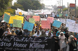 FILE - Pakistani women stage a rally to protest against domestic violence and sexual harassment as well as to demand greater economic opportunities.