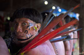 Yanomami Indians from two different villages meet in Novo Demini on the border between the states of Amazonas and Roraima, Oct. 15, 2012.