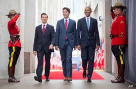 President Barack Obama, right, walks with Canadian Prime Minister Justin Trudeau, center, and Mexican President Enrique Pena Neito at the National Gallery of Canada in Ottawa, Canada, June 29, 2016. Obama traveled to Ottawa for the North America Lead