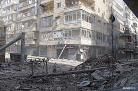 A street after clashes between Free Syrian Army fighters and forces loyal to Syria's President Bashar Al-Assad in Salah Edinne district in the center of Aleppo August 8, 2012.