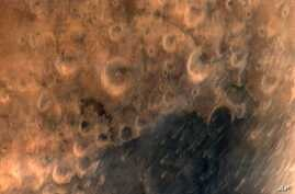 This image provided by the Indian Government Press Information Bureau shows what the agency says is one of the first images of the surface of Mars taken by India's Mars Orbiter Mission satellite, on Sept. 25, 2014.