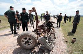 Thai army soldiers search the area of a roadside bomb blast in the southern province of Pattani,  June 19, 2017.