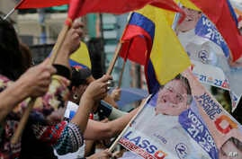 Opposition presidential candidate Guillermo Lasso's supporters protest outside Ecuador's National Electoral Council to demand the official results of the presidential elections, in Quito, Ecuador, Feb. 20, 2017.
