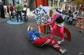 Occupy Wall Street activists perform in Zuccotti Park on the fifth anniversary of the movement in New York, Sept. 17, 2016.