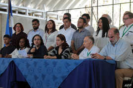 Nicaraguan Azaleah Solis (3-L), member of the opposition Civic Alliance for Justice, speaks during a press conference in Managua, March 19, 2019.