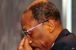 An emotional former Haitian president Jean-Bertrand Aristide is seen at the OR Tambo Southern Sun hotel in Johannesburg, 15 Jan 2010