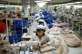 FILE -  North Korean workers assemble jackets at a factory of a South Korean-owned company at the jointly run Kaesong Industrial Complex in Kaesong, North Korea, Dec. 19, 2013.