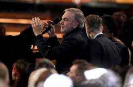 "Neil Diamond leads a carpool karaoke performance of ""Sweet Caroline"" at the 59th annual Grammy Awards, Feb. 12, 2017, in Los Angeles."