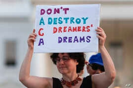 Trump ImmigrationJulia Paley, of Arlington, Va., with the DMV Sanctuary Congregation Network, holds up a sign during a rally supporting Deferred Action for Childhood Arrivals, or DACA, outside the White House, in Washington, Sept. 4, 2017.