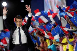 French independent centrist presidential candidate Emmanuel Macron waves to his supporters during a campaign rally in Paris, May 1st, 2017.