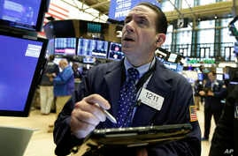 Trader Tommy Kalikas works on the floor of the New York Stock Exchange, May 7, 2018.