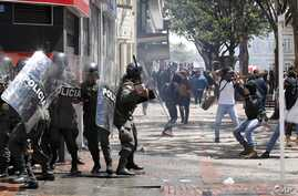 Protesters challenge riot police during clashes in downtown Bogota, Colombia, Aug. 29, 2013.