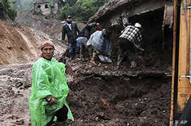 Massive Landslide Buries Homes in Mexico's Oaxaca State