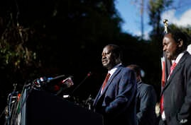 "Kenya's opposition leader Raila Odinga, center, accompanied by party official Kalonzo Musyoka, right, announces they will challenge the results of last week's presidential election in the Supreme Court and wage a campaign of ""civil disobedience,"" at"