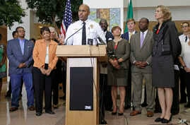 Charlotte Police Chief Kerr Putney speaks as city officials including Charlotte mayor Jennifer Roberts, right, listen during a news conference after a second night of violence following Tuesday's fatal police shooting of Keith Lamont Scott in Charlot...