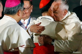 Pope Francis embraces Philippine Cardinal Luis Antonio Tagle upon his arrival at Villamor Air Base in Manila, for a state and pastoral visit, Jan. 15, 2015.