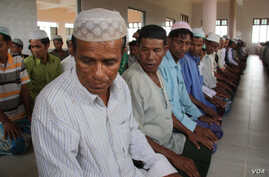 Men pray at a mosque, Rakhine State, Burma, November, 2012. (D. Schearf/VOA)