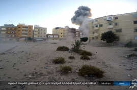 This photo posted on a file sharing website, Jan. 11, 2017, by the Islamic State Group in Sinai, a militant organization, shows an explosion as militants attack an Egyptian police checkpoint on Jan. 9, 2017, in el-Arish, north Sinai, Egypt.