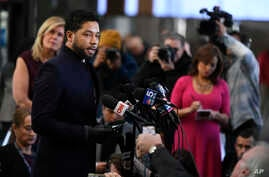 Actor Jussie Smollett talks to the media before leaving Cook County Court after his charges were dropped March 26, 2019, in Chicago.