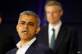 Sadiq Khan, Labor Party candidate, speaks in front of Zac Goldsmith, Conservative Party candidate, after winning the London mayoral elections, at City Hall, London, May 7, 2016.
