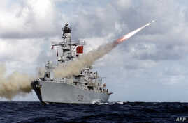 In this handout picture retrieved on February 10, 2016 from the British Ministry of Defence (MOD) via Defence News Imagery the British Royal Navy Type 23 frigate, HMS Iron Duke, is pictured at sea firing her Harpoon anti-ship missile system.