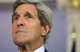 Secretary of State John Kerry is seen at the State Department in Washington, July 29, 2013.