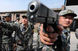 Chinese soldiers practice with their pistols at an undisclosed training camp in central China's Henan province (File)