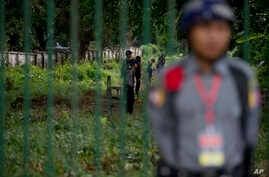 Myanmar police officers stand guard outside the Yangon University, a venue of an event attended by US President Barack Obama in Yangon Myanmar, Friday, Nov. 14, 2014.
