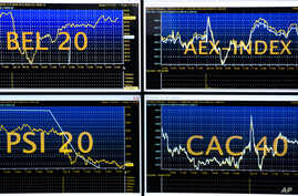 Screens show indexes at the Euronext headquarters in the business district la Defense, outside Paris, Tuesday, Jan. 10, 2017.