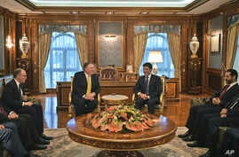 Secretary of State Mike Pompeo, center left, meets with Nechirvan Barzani, outgoing Prime Minister of Iraq's autonomous Kurdistan Regional Government (KRG), in the province's capital Erbil, Iraq, during a Middle East tour, Wednesday, Jan. 9, 2019.