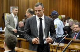 Olympic and Paralympic track star Oscar Pistorius arrives in court ahead of his trial at the North Gauteng High Court in Pretoria, March 3, 2014.